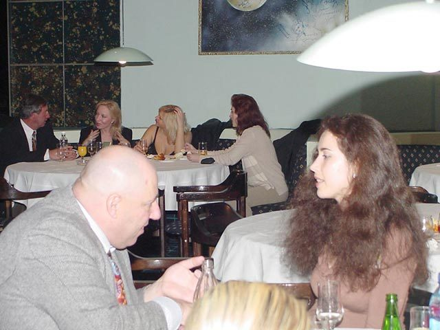 A client talking to his potential partner among lovely Russian women