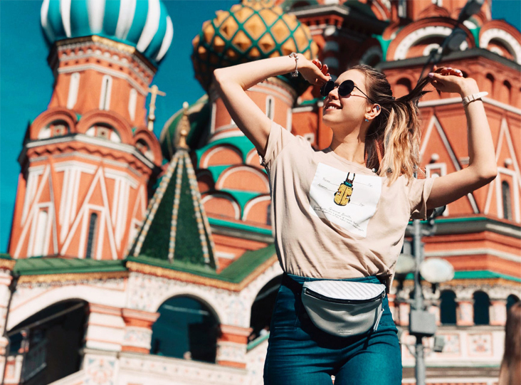 A candid shot of a woman in the facade of the St. Basil's Cathedral, Moscow